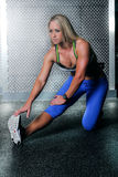 Fitness woman doing a hamstring stretch Royalty Free Stock Photography