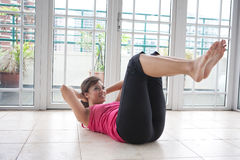 Fitness woman doing her crunching exercise Stock Images