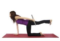 Fitness woman doing kneeling triceps kickback Stock Images