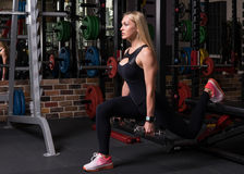 Fitness woman doing lunge squat exercise royalty free stock photography
