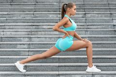Fitness woman doing lunges exercises for leg muscle workout training outdoor. Active girl doing front forward one leg step lunge stock images