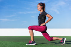 Fitness woman doing lunges leg workout exercises. Fitness woman doing lunges exercises for glute and leg muscle workout training core muscles, balance, cardio Stock Photo