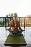 Fitness woman doing meditation at health club Royalty Free Stock Images
