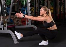 Fitness woman doing pistol squat royalty free stock image
