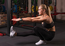 Fitness woman doing pistol squat Stock Photo