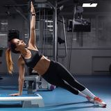 Fitness woman doing planking exercise at the gym, sporty girl workout.  royalty free stock photography