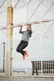 Fitness woman doing pull ups workout Stock Photography