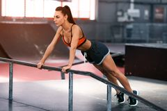 Fitness woman doing push-ups, cross training workout. Sporty girl training Royalty Free Stock Images