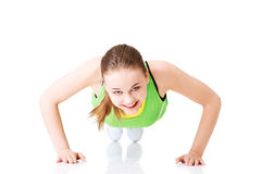 Fitness woman doing push ups Royalty Free Stock Photography