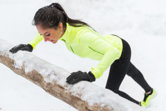 Fitness woman doing push ups Outdoor training workout winter forest. Royalty Free Stock Photos