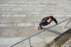 Fitness woman doing push ups workout Stock Photo