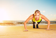 Fitness woman doing push ups Royalty Free Stock Photos