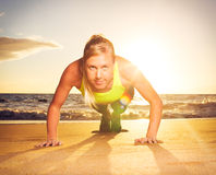 Fitness woman doing push ups Stock Images
