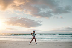 Fitness woman doing running exercise on the beach Royalty Free Stock Image