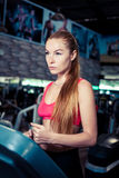 Fitness woman doing running exerciseon on a treadmill in the health club. stock photography