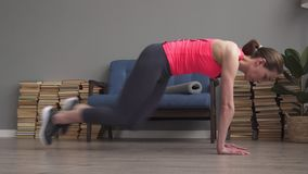 Fitness woman doing running plank exercise on floor stock footage