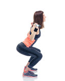Fitness woman doing squatting with barbell Stock Photography