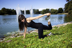 Fitness woman doing a stretch Royalty Free Stock Photography