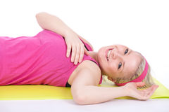 Fitness woman doing stretching exercise Royalty Free Stock Photo