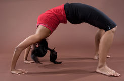 Fitness woman doing stretching exercises Royalty Free Stock Photos