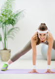 Fitness woman doing stretching exercises Royalty Free Stock Image