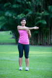 Fitness woman doing stretching exercises. Outdoor in the park royalty free stock photo