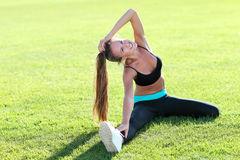 Fitness woman doing stretching exercises Royalty Free Stock Images