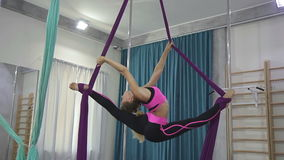 Fitness woman doing stretching legs hammock in sports club indoors. stock video