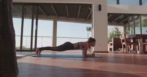 Fitness woman doing stretching work out at home stock video footage