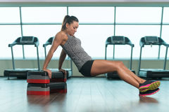 Fitness Woman Doing Triceps Exercise On Stepper Stock Photo