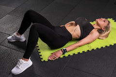 Fitness woman doing a vacuum exercise Royalty Free Stock Photography