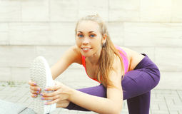 Fitness woman doing warm-up stretching exercise before run, female athlete ready to workout in city, sport and healthy lifestyle Stock Photos