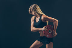 Fitness woman doing  weight training by lifting a Royalty Free Stock Image