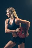 Fitness woman doing  weight training by lifting a Royalty Free Stock Photo