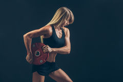 Fitness woman doing  weight training by lifting a heavy weights Royalty Free Stock Image