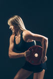 Fitness woman doing  weight training by lifting a heavy weights Royalty Free Stock Photography