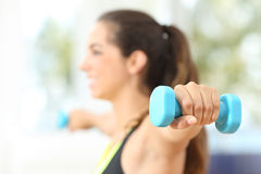 Fitness woman doing weights at home Royalty Free Stock Photography