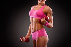 Fitness woman doing workout with dumbbells Stock Photo