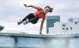 Fitness woman doing workout on rooftop royalty free stock image