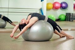 Fitness Woman Doing Workout on a Yoga Ball Stock Image