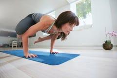 Fitness woman doing yoga handstand - Bakasana Royalty Free Stock Photography