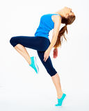 Fitness woman dooing gym exercise. Royalty Free Stock Images