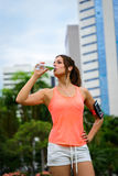 Fitness woman driking water on workout rest Stock Photography