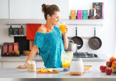 Fitness woman drinking pumpkin smoothie royalty free stock photos