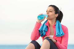 Fitness woman drinking Royalty Free Stock Photography