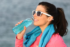 Fitness woman drinking after sport training Stock Photography