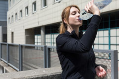 Fitness woman drinking water. Attractive fitness woman drinking water after running Stock Photo