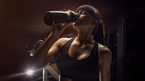 Fitness woman drinking water from bottle Royalty Free Stock Photography