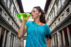Fitness woman drinking water near uffizi gallery. In florence, italy Stock Images