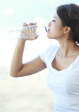 Fitness woman drinking water Stock Image